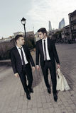 Purchase of businessmen,shopping guys. Together Stock Photography