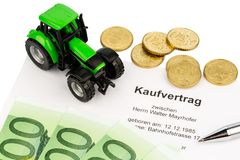 Purchase contract for new farm tractor Stock Photography