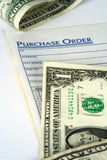 Purchase Order. With money Stock Photography