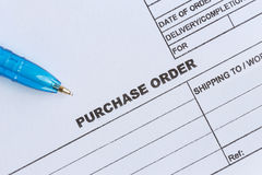 Purchase order with blue pen in the office Stock Photos