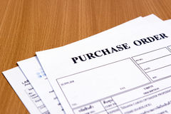 Purchase order form on wooden table Royalty Free Stock Photo