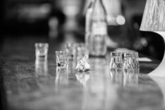 Purchase and payment. Cash money concept. Leave tips for bartender. Tip given to waiter. Crumpled money cash at bar. Counter. Empty glasses and bottle on table stock images