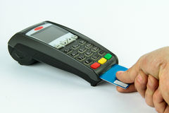 Purchasing with a credit card reader or POS-terminal. A Pos and credit card reader making a payment with credit card Royalty Free Stock Photo