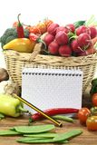 Purchasing paper with a basket fresh vegetables Royalty Free Stock Photography