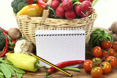 Purchasing paper with pencil and vegetables Stock Photos