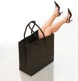 Purchasing power. Shopping conceptual photo with woman's legs in the bag Stock Photo