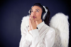 Pure angel listening to music. Girl with angel wings listening music royalty free stock photo