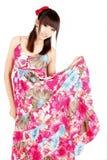 Pure Asian girl. Wearing a beautiful dress posing on white Royalty Free Stock Image