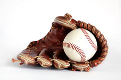 Pure baseball. Baseball glove and ball on a white background Stock Photo