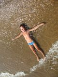 Pure beach. Boy in water on pure beach Royalty Free Stock Images