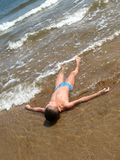 Pure beach. Boy in water on pure beach Royalty Free Stock Photography