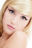 Pure beauty. Close-up portrait of beautiful blond young girl with trendy makeup Stock Image