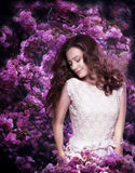 Pure Beauty. Dreamy Young Woman among Flowering Trees Royalty Free Stock Photo