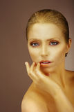 Pure Beauty. Gilded Woman's Face Royalty Free Stock Image