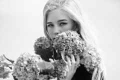 Pure beauty. Tenderness of young skin. Springtime bloom. Girl tender blonde hold hydrangea flowers bouquet. Natural royalty free stock photos