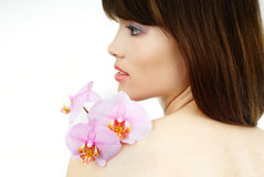 Pure beauty - woman with an orchid on her arm royalty free stock photo