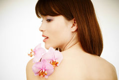 Pure beauty - woman with an orchid on her arm stock photography
