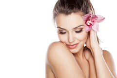 Pure Beauty. Young beautiful woman posing with orchid Stock Photos