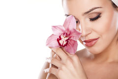 Pure Beauty. Young beautiful woman with a towel on her head posing with orchid stock photo