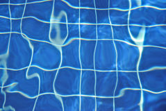 Pure blue water in the pool. Water background. Royalty Free Stock Image