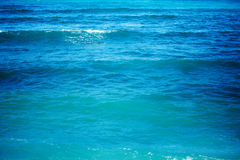 Pure blue water with sea wave. Clean blue background Stock Images