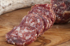 Pure boar salami. Slices of olive burl teapots stock photo