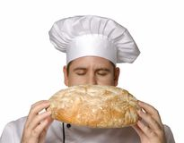 Pure bread. Cook holding bread. Chef holding bread Stock Photography