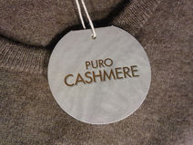 Pure Cashmere sign on light chocolate color sweater Stock Image