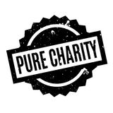 Pure Charity rubber stamp. Grunge design with dust scratches. Effects can be easily removed for a clean, crisp look. Color is easily changed Royalty Free Stock Images