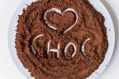 Pure cocoa powder. In a dish with a word on it stock photo