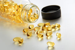 Pure Cod Liver Oil. With simple setup on clean lighting royalty free stock photos