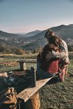 Pure feelings. Beautiful young couple having morning coffee whil. E spending carefree time in mountains Royalty Free Stock Images