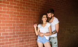 Pure feelings. Couple in love hugs brick wall background. Couple find place to enjoy feelings. Couple enjoy intimacy. Cuddling without witnesses. Girl and royalty free stock images