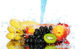 Pure fruit in a spray of water Stock Photography