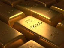 Pure Gold. 1000 grams of pure gold. Depth of field in the gold word Stock Photos