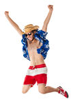 Pure happyness. A young, attractive male in a colorful outfit ready to travel as a stereotype tourist Royalty Free Stock Images