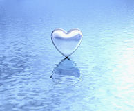 Pure heart on water reflection. Shiny silver heart above reflective lake. Reflection of love, clear love and peaceful mind Stock Photo