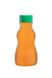 Pure honey in plastic bottle Royalty Free Stock Photography