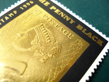 Post stamp. Pure 22 karat gold post stamp from Buthan Royalty Free Stock Photos