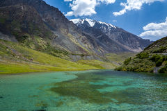 Pure lake of Tien Shan mountains, Kyrgyzstan Royalty Free Stock Photo