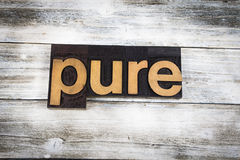 Pure Letterpress Word on Wooden Background Royalty Free Stock Image