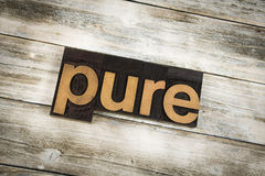 Pure Letterpress Word on Wooden Background Royalty Free Stock Images