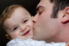 Pure love. Father kissing his baby son royalty free stock image