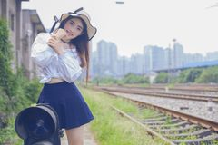 Pure and lovely Asian girl. Pretty lovely girl and rail background. A slightly retro portrait. Play on the rails royalty free stock photo