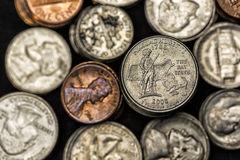 Pure Metal. Variety of U.S. coins, focus on the quarter Royalty Free Stock Photo