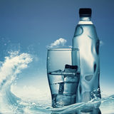 Pure mineral water against ocean surface. Healthy life concept Stock Photography