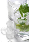 Pure mineral water with ice and lemon. Glasses full of pure mineral water with ice and lemon Stock Images