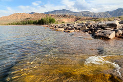 Pure, mountain lake. Lake  Issyk-kyl, Kyrgyzstan.Summer landscape Stock Photography