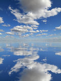 Pure Nature. Pure water surface with clouds reflection from above Royalty Free Stock Images