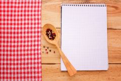 Pure notebook for recording menu, recipe on red checkered tablecloth tartan. Stock Images